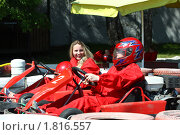 Купить «Картинг. Девушки делятся впечатлениями», фото № 1816557, снято 21 мая 2010 г. (c) Татьяна Белова / Фотобанк Лори