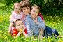 Женщина с тремя детьми отдыхает на поляне, фото № 1826405, снято 15 мая 2010 г. (c) Ермилова Арина / Фотобанк Лори
