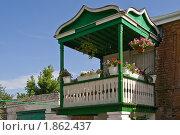 Купить «Деревянный балкон с цветами», фото № 1862437, снято 19 июня 2010 г. (c) Борис Панасюк / Фотобанк Лори