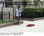 Уличный музыкант.Чикаго. США (2010 год). Редакционное фото, фотограф Marina Butirskaya / Фотобанк Лори
