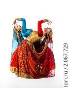 Купить «Две девушки танцуют индийский танец», фото № 2067729, снято 10 сентября 2010 г. (c) Гурьянов Андрей / Фотобанк Лори