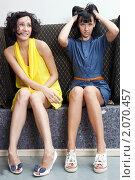 Купить «Девушки сидят на диване», фото № 2070457, снято 6 сентября 2010 г. (c) Elena Rostunova / Фотобанк Лори