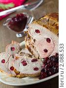 Купить «Запеченная свинина с клюквенным соусом», эксклюзивное фото № 2088533, снято 14 октября 2010 г. (c) Лидия Рыженко / Фотобанк Лори