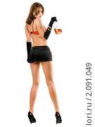 Купить «Молодая женщина в мини-юбке и красном бюстгальтере с бутылкой алкоголя», фото № 2091049, снято 1 сентября 2009 г. (c) Сергей Сухоруков / Фотобанк Лори