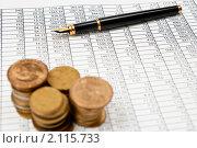 Купить «Экономические таблицы, стопки монет и перьевая ручка», фото № 2115733, снято 2 октября 2010 г. (c) Сергей Дашкевич / Фотобанк Лори