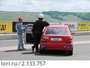 Купить «Автогонщик около своего спортивного автомобиля», фото № 2133757, снято 6 июня 2010 г. (c) Юрий Андреев / Фотобанк Лори