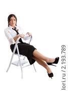 Купить «Девушка в деловом костюме сидит на лесенке», фото № 2193789, снято 15 августа 2010 г. (c) Сергей Дубров / Фотобанк Лори