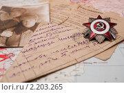 Орден Отечественной войны и солдатское письмо полевой почты. Стоковое фото, фотограф Igor Lijashkov / Фотобанк Лори