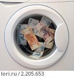 Купить «Отмывание денег в стиральной машине», фото № 2205653, снято 10 декабря 2010 г. (c) Галаганов Дмитрий Александрович / Фотобанк Лори