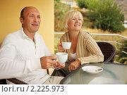 Купить «Зрелая пара пьет кофе», фото № 2225973, снято 8 октября 2010 г. (c) Andrejs Pidjass / Фотобанк Лори