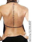Купить «Молодая женщина с татуировкой на спине», фото № 2310657, снято 5 сентября 2009 г. (c) Сергей Сухоруков / Фотобанк Лори