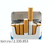 Открытая пачка сигарет. Стоковое фото, фотограф Roman Firsov / Фотобанк Лори