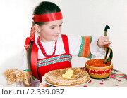 Купить «Девочка в русском народном костюме за столом с блинами и красной икрой . Масленица.», фото № 2339037, снято 11 февраля 2011 г. (c) RedTC / Фотобанк Лори