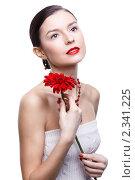 Купить «Девушка с цветком герберы», фото № 2341225, снято 17 декабря 2010 г. (c) Serg Zastavkin / Фотобанк Лори