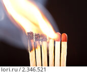 Горящие спички на черном фоне. Стоковое фото, фотограф Никончук Алексей / Фотобанк Лори