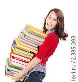 Купить «Темноволосая девушка с кучей книг», фото № 2385393, снято 14 декабря 2010 г. (c) Gennadiy Poznyakov / Фотобанк Лори