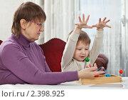 Купить «Бабушка и внук», фото № 2398925, снято 6 февраля 2011 г. (c) Михаил Лавренов / Фотобанк Лори