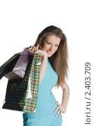 Купить «Девушка с покупками», фото № 2403709, снято 12 февраля 2011 г. (c) Черников Роман / Фотобанк Лори