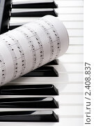 Купить «Клавиши пианино и ноты», фото № 2408837, снято 14 марта 2011 г. (c) Угоренков Александр / Фотобанк Лори