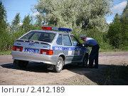 Купить «Составление протокола», фото № 2412189, снято 21 июля 2010 г. (c) Наталья Волкова / Фотобанк Лори