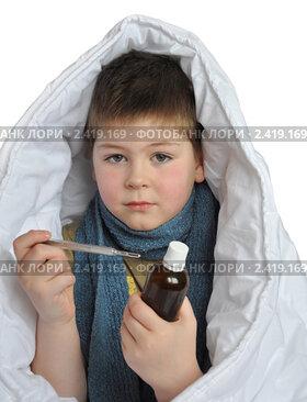 Купить «Больной мальчик с лекарством и градусником изолированно на белом фоне», фото № 2419169, снято 20 марта 2011 г. (c) Володина Ольга / Фотобанк Лори