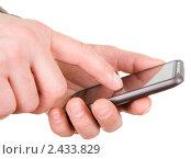 Купить «Коммуникатор в руке», фото № 2433829, снято 28 марта 2011 г. (c) паша семенов / Фотобанк Лори