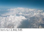 Купить «Облака и горы из иллюминатора самолета», фото № 2442545, снято 31 июля 2010 г. (c) Elena Monakhova / Фотобанк Лори