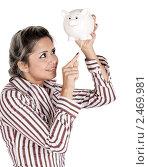 Купить «Девушка пытается достать деньги из копилки», фото № 2469981, снято 28 января 2020 г. (c) Marina Appel / Фотобанк Лори