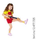 Купить «Маленькая девочка танцует с игрушечной гитарой в руках, изолировано на белом фоне», фото № 2477725, снято 2 февраля 2011 г. (c) pzAxe / Фотобанк Лори