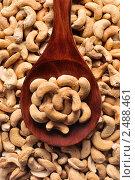 Купить «Орехи кешью в деревянной ложке», фото № 2488461, снято 3 апреля 2011 г. (c) Денис Ларкин / Фотобанк Лори