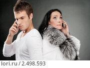 Купить «Юноша и взрослая женщина говорят по телефону», фото № 2498593, снято 10 ноября 2010 г. (c) BestPhotoStudio / Фотобанк Лори