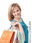 Купить «Девушка с покупками», фото № 2536493, снято 2 апреля 2011 г. (c) Raev Denis / Фотобанк Лори
