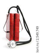 Купить «Стетоскоп на красных книгах», фото № 2549749, снято 9 мая 2010 г. (c) Elnur / Фотобанк Лори