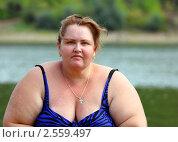 Купить «Полная женщина у реки», фото № 2559497, снято 14 августа 2009 г. (c) Михаил Коханчиков / Фотобанк Лори