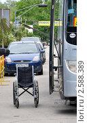Купить «Пустая инвалидная коляска у автобуса на городской улице», фото № 2588389, снято 11 июня 2011 г. (c) Анна Мартынова / Фотобанк Лори