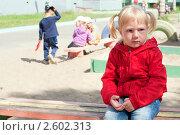 Купить «Грустная девочка на прогулке в детском саду», фото № 2602313, снято 17 июня 2011 г. (c) Марина Славина / Фотобанк Лори