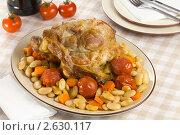 Купить «Запеченная свинина с гарниром из фасоли с томатами», эксклюзивное фото № 2630117, снято 26 мая 2011 г. (c) Александр Курлович / Фотобанк Лори