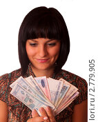 Купить «Молодая симпатичная девушка держит веером белорусские купюры», фото № 2779905, снято 6 сентября 2011 г. (c) Ольга Аристова / Фотобанк Лори