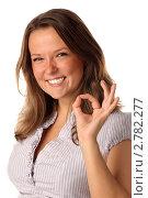 """Купить «Веселая девушка, показывающая жест """"Ok"""", на белом фоне», фото № 2782277, снято 22 октября 2010 г. (c) Самохвалов Артем / Фотобанк Лори"""