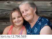 Купить «Пожилая женщина с внучкой», фото № 2796569, снято 30 июля 2011 г. (c) Вадим Иванов / Фотобанк Лори