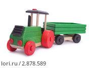 Купить «Игрушечный деревянный трактор», фото № 2878589, снято 16 октября 2011 г. (c) Сергей Прищепа / Фотобанк Лори