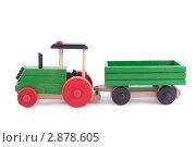 Купить «Игрушечный деревянный трактор», фото № 2878605, снято 16 октября 2011 г. (c) Сергей Прищепа / Фотобанк Лори