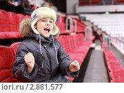 Купить «Мальчик сидит на трибунах стадиона», фото № 2881577, снято 20 февраля 2010 г. (c) Losevsky Pavel / Фотобанк Лори