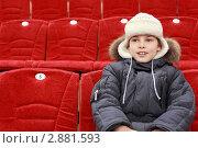 Купить «Мальчик сидит на трибунах стадиона», фото № 2881593, снято 20 февраля 2010 г. (c) Losevsky Pavel / Фотобанк Лори