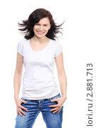 Купить «Красивая молодая брюнетка в белой майке и джинсах», фото № 2881713, снято 4 апреля 2010 г. (c) Losevsky Pavel / Фотобанк Лори