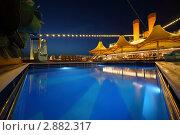 Купить «Плавательный бассейн в вечернем освещении на палубе круизного судна», фото № 2882317, снято 13 апреля 2010 г. (c) Losevsky Pavel / Фотобанк Лори