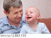 Купить «Пожилой мужчина с внуком на руках», фото № 2883133, снято 21 апреля 2010 г. (c) Losevsky Pavel / Фотобанк Лори