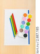 Купить «Краски, карандаши на тетрадном листе», фото № 2887185, снято 29 августа 2010 г. (c) Elnur / Фотобанк Лори