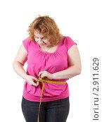 Полная женщина с измерительной лентой. Стоковое фото, фотограф Яков Филимонов / Фотобанк Лори