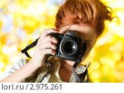 Купить «Стильная рыжеволосая девушка-фотограф на ярком желтом фоне», фото № 2975261, снято 9 октября 2010 г. (c) chaoss / Фотобанк Лори